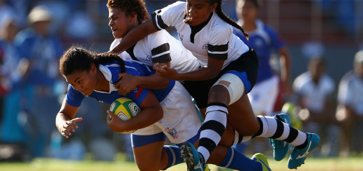 APIA, SAMOA - SEPTEMBER 09:  Teuila Aukusitino of Samoa is tackled by Airini Vuidravuwalu and Jiowana Sauto of Fiji during the girls match between Samoa and Fji in the rugby sevens competition at the Apia Park Sports Complex on day three of the Samoa 2015 Commonwealth Youth Games on September 9, 2015 in Apia, Samoa.  (Photo by Mark Kolbe/Getty Images)