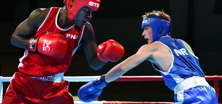 APIA, SAMOA - SEPTEMBER 10:  Thadeus Katoa (red) of Papua New Guinea and Tiernan Bradley (blue) of Northern Ireland box during the Youth's Light 60kg - Boxing Final at the Tuanaimato Sports Facility on day four of the Samoa 2015 Commonwealth Youth Games on on September 10, 2015 in Apia, Samoa.  (Photo by Scott Barbour/Getty Images)