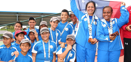 APIA, SAMOA - SEPTEMBER 11:  Samoa pose with their medals and ballkids during the medal ceremony for the Womens Doubles Tennis at the Apia Park Sports Complex on day five of the Samoa 2015 Commonwealth Youth Games on September 11, 2015 in Apia, Samoa.  (Photo by Scott Barbour/Getty Images)