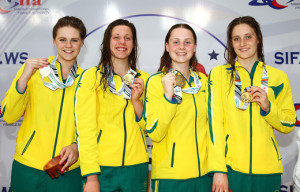 Australia pose with their gold medals after the medal presentation for the 4 x 100m Freestyle Relay - Women's Final at the Aquatic Centre of the Tuanaimato Sports Facility