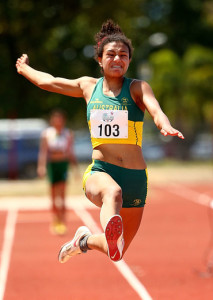 Billie Arch of Australia jumps as she competes in the Girls Long Jump during the Athletics at the Apia Park Sports Complex