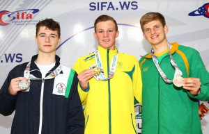 Conor Ferguson of Northern Ireland, Tristan Ludlow of Australia and Neil Fair of South Africa pose with their medals after the medal presentation for the 200m Backstroke - Men at the Aquatic Centre