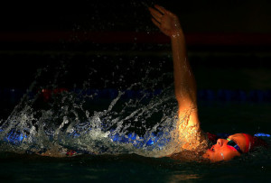 Nathan Corrigan of Jersey competes in the Men's 200m Backstroke Final at the Aquatic Centre of the Tuanaimato Sports Facility on day three of the Samoa 2015 Commonwealth Youth Games