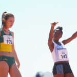 jacinta-beecher-of-australia-and-refilwe-murangi-of-botswana-prepare-for-the-girls-100m-heat-during-the-athletics-competition-at-the-apia-park-sports-complex-2