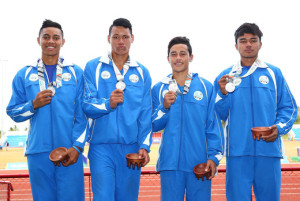 Junior Palamo, Joe Fruean, Luatimu Samau and William Brown of Samoa pose with their medals after the medal presentation for the Boys 4x200 Metre Relay