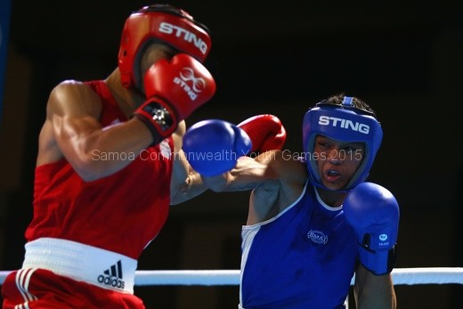 benjamin-whittaker-of-england-blue-and-siaosi-fenukitau-of-tonga-red-box-during-their-youths-75kg-quarterfinal-bout-at-the-tuanaimato-sports-facility-2