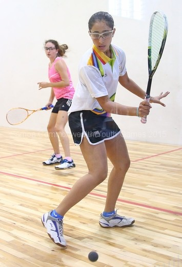 harshit-kaur-jawanda-of-india-plays-a-shot-during-her-match-against-susanna-armano-of-bermuda-during-the-womens-singles-squash-2