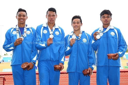 junior-palamo-joe-fruean-luatimu-samau-and-william-brown-of-samoa-pose-with-their-medals-after-the-medal-presentation-for-the-boys-4x200-metre-relay-2