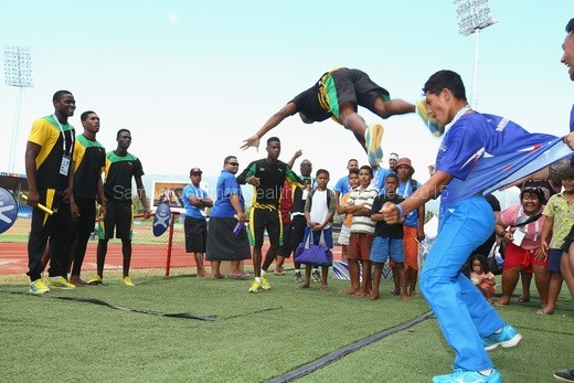 members-of-the-samoa-and-jamaica-track-and-field-teams-take-part-in-a-dance-off-after-the-conclusion-of-the-the-athletics-competition-at-the-apia-park-sports-complex-2